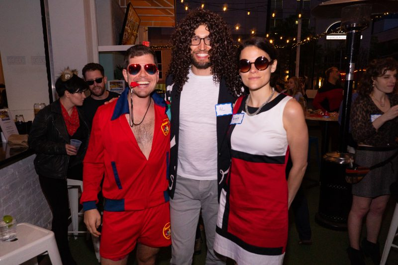 Young adults dress up in costumes for a fun social event
