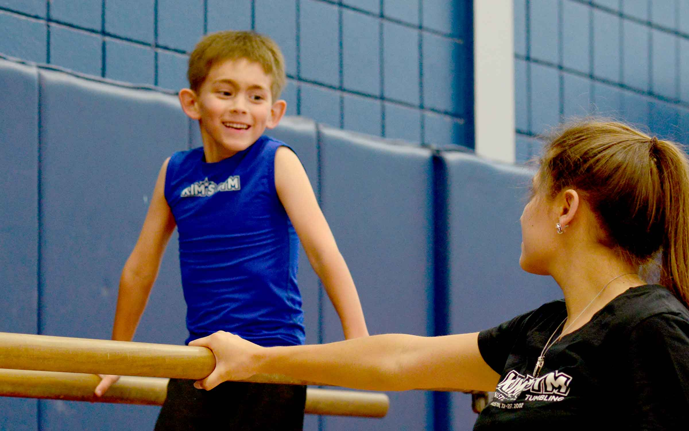 A boy practices gymnastics during a private lesson.