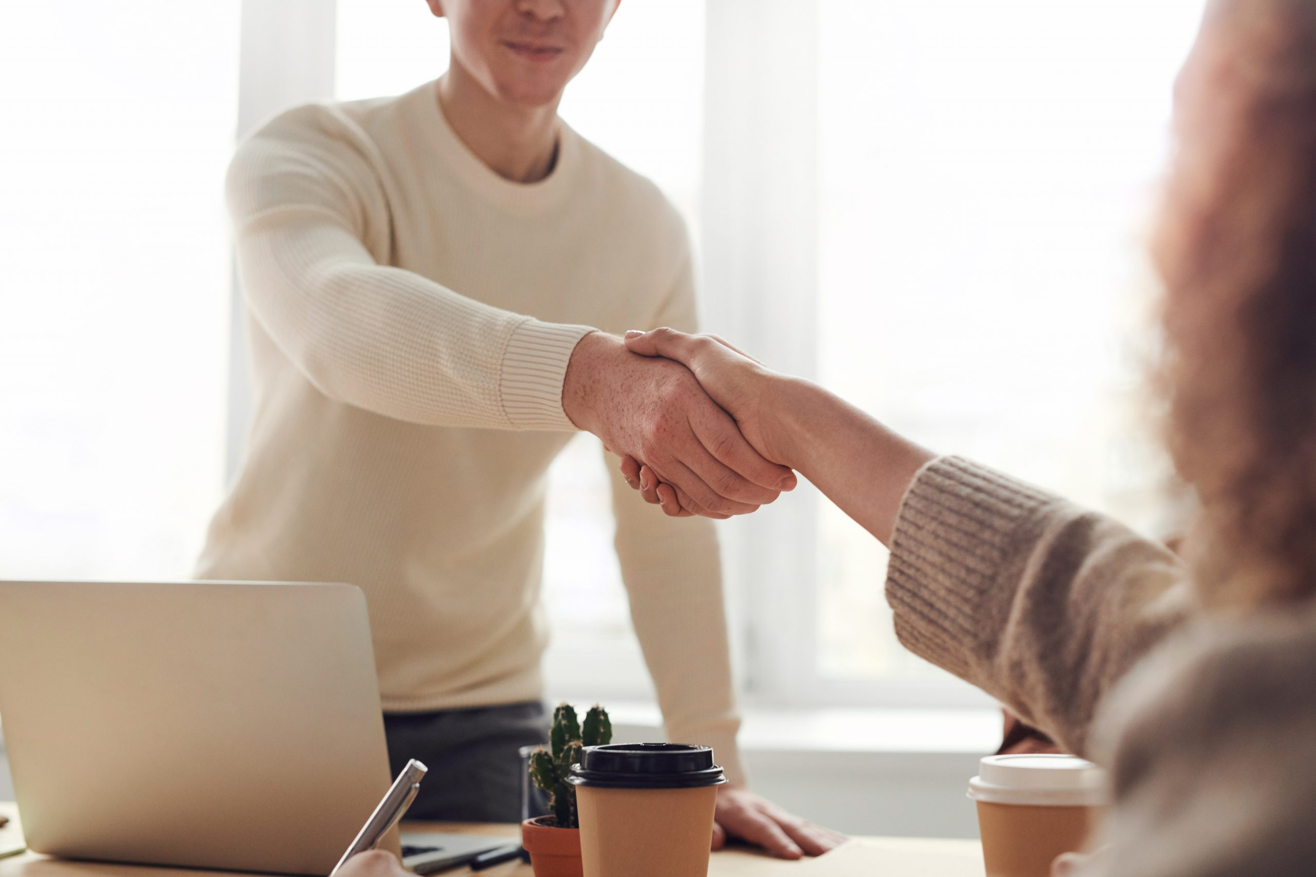 Two people meeting and shaking hands